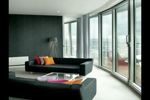 The wedge-shaped flats open out towards the wide panoramas beyond the floor-to-ceiling glazing.